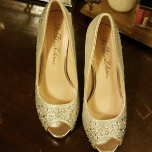 Bejeweled glittery silver peep toe pumps